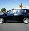 nissan versa 2007 black hatchback 1 8 s gasoline 4 cylinders front wheel drive 6 speed manual 98371