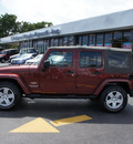 jeep wrangler unlimited 2007 red suv sahara gasoline 6 cylinders rear wheel drive automatic 33021