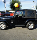 jeep wrangler 2004 black suv sahara gasoline 6 cylinders 4 wheel drive automatic with overdrive 98371