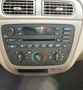 ford taurus 2005 tan sedan se gasoline 6 cylinders front wheel drive automatic 14224