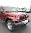 jeep wrangler unlimited 2010 red suv sahara gasoline 6 cylinders 4 wheel drive manual 45324