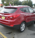 hyundai tucson 2011 red gasoline 4 cylinders all whee drive automatic 13502