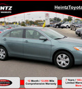 toyota camry 2009 green sedan le gasoline 4 cylinders front wheel drive automatic 56001