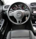 volkswagen jetta 2011 red wagon sportwagen se gasoline 5 cylinders front wheel drive automatic 98226