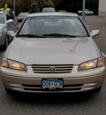 toyota camry 1997 beige sedan le gasoline 4 cylinders front wheel drive automatic with overdrive 56001