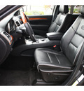 jeep grand cherokee 2011 black suv overland gasoline 8 cylinders 4 wheel drive automatic 99352