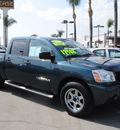 nissan titan 2007 green xe gasoline 8 cylinders rear wheel drive automatic 91010