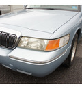 mercury grand marquis 2002 light ice blue sedan ls premium gasoline 8 cylinders rear wheel drive automatic with overdrive 07712