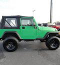 jeep wrangler 2004 green suv sport gasoline 6 cylinders 4 wheel drive 5 speed manual 60915