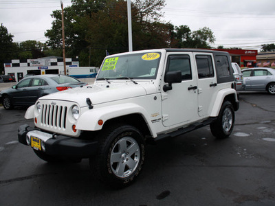 jeep wrangler unlimited 2010 white suv sahara gasoline 6 cylinders 4 wheel drive automatic with overdrive 07730