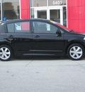 nissan versa 2011 black hatchback sl gasoline 4 cylinders front wheel drive automatic 33884