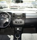 nissan versa 2009 dk  gray hatchback s gasoline 4 cylinders front wheel drive 6 speed manual 76205