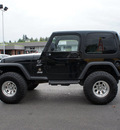 jeep wrangler 1999 black suv sport gasoline 6 cylinders 4 wheel drive 5 speed manual 98371