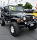 jeep wrangler 1999 black suv sport gasoline 6 cylinders 4 wheel drive 5 speed manual 98371
