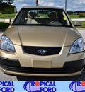 kia rio 2009 gold sedan lx gasoline 4 cylinders front wheel drive automatic 32837