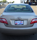 toyota camry 2007 gold sedan gasoline 4 cylinders front wheel drive standard 79925