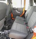 jeep wrangler unlimited 2011 orange suv sport gasoline 6 cylinders 4 wheel drive automatic 81212