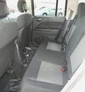 jeep patriot 2011 bright white suv latitude gasoline 4 cylinders 4 wheel drive 5 speed manual 81212