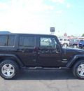 jeep wrangler unlimited 2008 black suv sahara gasoline 6 cylinders 4 wheel drive automatic 98632