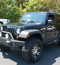 jeep wrangler unlimited 2010 black suv sport gasoline 6 cylinders 4 wheel drive 6 speed manual 27330