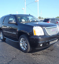 gmc yukon 2011 black suv denali flex fuel 8 cylinders all whee drive automatic with overdrive 28557