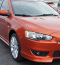mitsubishi lancer 2009 orange sedan gts gasoline 4 cylinders front wheel drive automatic 33021