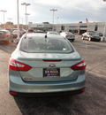 ford focus 2012 lt  blue sedan se gasoline 4 cylinders front wheel drive automatic with overdrive 60546