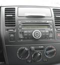 nissan versa 2009 silver sedan 1 8 s gasoline 4 cylinders front wheel drive automatic 34788