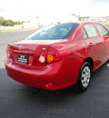 toyota corolla 2009 red sedan le gasoline 4 cylinders front wheel drive automatic 45344