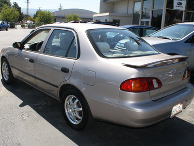 toyota corolla 2000 silver sedan ce gasoline 4 cylinders front wheel drive automatic with overdrive 94063