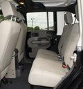jeep wrangler unlimited 2007 black suv sahara gasoline 6 cylinders 4 wheel drive 6 speed manual 98371