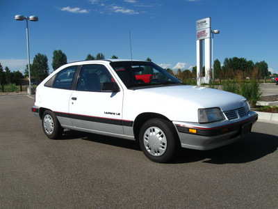 pontiac le mans 1990 bright white hatchback le gasoline 4 cylinders front wheel drive automatic 80504