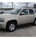 chevrolet tahoe 2011 gold suv ls flex fuel 8 cylinders 2 wheel drive 6 spd auto,elec cntlled 77090