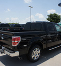 ford f 150 2011 black lariat flex fuel 8 cylinders 2 wheel drive automatic 76205