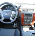 chevrolet suburban 2011 black suv ls 1500 flex fuel 8 cylinders 2 wheel drive 6 spd auto,hd,elec cntll 77090