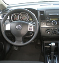 nissan versa 2009 silver hatchback gasoline 4 cylinders front wheel drive automatic with overdrive 13212