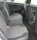ford taurus 2011 white sedan sel gasoline 6 cylinders front wheel drive 6 speed automatic 76205