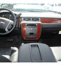 chevrolet suburban 2011 silver suv lt 1500 flex fuel 8 cylinders 2 wheel drive automatic 77090