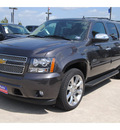 chevrolet suburban 2011 dk  gray suv lt 1500 flex fuel 8 cylinders 2 wheel drive automatic 77090