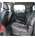 chevrolet suburban 2011 dk  gray suv lt 1500 flex fuel 8 cylinders 2 wheel drive automatic 77090