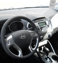 hyundai tucson 2011 diamond silver suv gls gasoline 4 cylinders all whee drive 6 speed automatic 99208