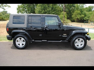 jeep wrangler unlimited 2010 black suv sahara gasoline 6 cylinders 4 wheel drive 75570
