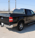 ford f 150 2005 black xlt gasoline 8 cylinders rear wheel drive automatic with overdrive 76087