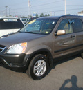 honda cr v 2004 tan suv ex gasoline 4 cylinders all whee drive automatic with overdrive 13502