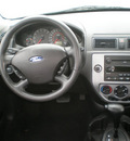 ford focus 2006 red hatchback zx5 gasoline 4 cylinders front wheel drive automatic with overdrive 13502