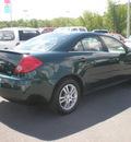 pontiac g6 2006 green sedan se1 gasoline 6 cylinders front wheel drive automatic 13502
