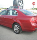 volkswagen jetta 2006 red sedan gasoline 5 cylinders front wheel drive 5 speed manual 13502