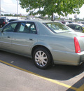 cadillac dts 2007 light green sedan gasoline 8 cylinders front wheel drive automatic 13502