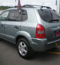 hyundai tucson 2007 lt blue suv gasoline 4 cylinders 4 wheel drive 5 speed manual 13502