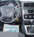 dodge caliber 2010 white hatchback sxt gasoline 4 cylinders front wheel drive automatic 34474